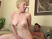 Slim granny rides her lover's rigid dick in cowgirl position