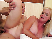 Slutty mature woman with big tits gets fucked in sideways position