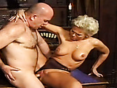 Busty blond haired secretary has steamy sex with her boss in the office