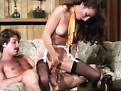 Dark haired filthy wench in stockings had hot sex with her man on sofa