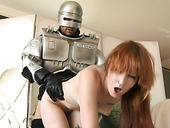 Feverish dude in robot suit doggy fucks pretty ginger harlot hard