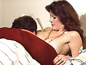 Pale bosomy redhead wakes up dude to get her wet pussy licked on bed