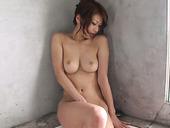Asian porn model Runa Sesaki stimulates her slit sitting in the corner .
