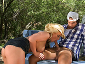 Slutty blond cowgirl Phoenix Marie sucks a cock in the trunk