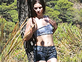 Slutty raven haired hottie performs steamy solo in woods