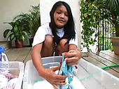 Kat Young is washing her clothes in front of cam outdoor