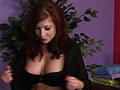 Ginger MILFie curvy masseuse jacks off strong hard cock in the parlor