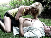 Alluring blonde doll gives head to an old guy in the park