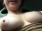 Kinky slutty brunette bitch flashes her pale boobs with nice nipples in the car