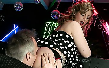 Classy chick in polka-dot dress loves having her pussy licked