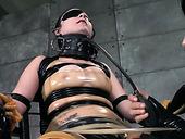 Latex mistress punishes blind folded brunette with whip