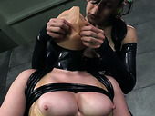 Flat chested chick finger fucks and toys tied up chick in latex outfit