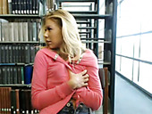Shameless blond chick presents nasty solo in the library