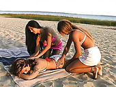 Three playful teens undress and fondle each other on a beach