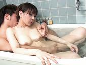 Sexy Japanese chick Myuu Tsubaki sucks soapy cock in the bath room