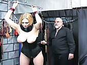 Big boobed MILF in tight black corset whipped in BDSM clip