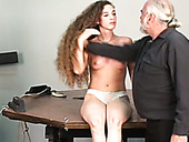 Inked submissive skank with long curly hair loves BDSM so much