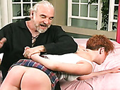 Old fart hits this redhead's juicy ass with a paddle for her bad behavior