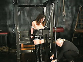 Mature hoe in corset and jackboots tormented in kinky BDSM vid