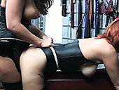 Red haired bitch in leather corset pounded hard with a strapon