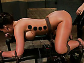 Mistress in latex makes tied up slave lick ass