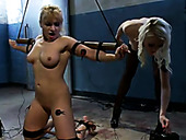 Belted and crucified blonde gets her pussy fucked with vibrator