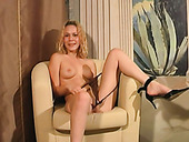 Video of naughty blonde masturbating on an armchair