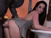 Curvaceous brunette Jayden Jaymes bends over in the bathroom