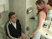 Perverted hooker gives her client a great blowjob in the toilet room