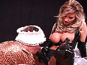 Torrid mistress in latex thigh high boots fucks her slave with a strap-on