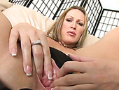 Perverted milf Mandy Bright spreads pussy curtains to expose pinkish cave