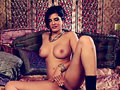 Appetizing brunette babe Sunny Leone gets rid of lingerie and goes solo