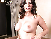 Busty seductive brunette hottie Sunny Leone fingers her juicy pussy