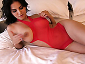 Charming big breasted Sunny Leone poses in her damn hot red stuff
