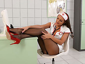 Filthy nurse sucks high heels and masturbates pussy without taking off pantyhose