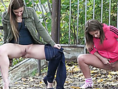 Two freaky dark haired teens piss a lot outdoors