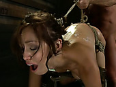 Suspended and tied up Audrey Rose gets her pussy finger fucked