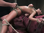 Suspended chick with tied up boobs Charley Chase gets her pussy punished