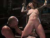 Submissive crucified brunette Sabrina Foxi gets slit fingerfucked