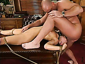 Crucified on the table tied up blond chick gives stout deepthroat blowjob