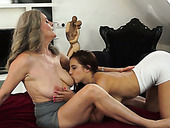 Dumpy girlie licks sweet kitty of her busty grey haired chick from behind