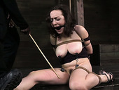 Juggy brunette gets her wet slit fucked with stick in torture room