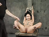 Asian sex-slave is fucked with  sex-machine in suspended position