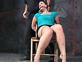 Very appetizing chick with plump ass is punished in the torture room