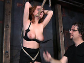 Breathtakingly hot redhead gets her big tits punished hard