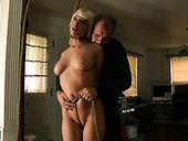 Suspended blonde Cherry suffocation scene