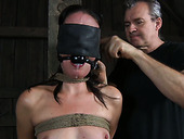 Suffocate porn model with ball gag gets punished in the dungeon