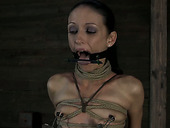 Tattooed sex-slave gets her slit fucked with sex toy in the dungeon