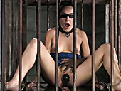 Sitting in the cage blindfolded brunette provides black dude with blowjob