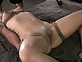 Hard tied submissive flushing brunette gets screwed by white and black dudes